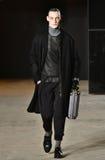 A model walks the runway wearing Robert Geller Stock Photo