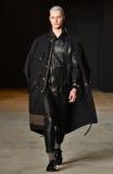 A model walks the runway wearing Robert Geller Stock Photography