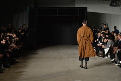 A model walks the runway wearing Robert Geller Stock Image