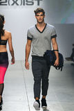 A model walks the runway during 2(X)IST Men's Spring/Summer 2016 Runway Show Stock Photography