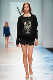 A model walks on the VICTORIA ANDREYANOVA catwalk Stock Photos