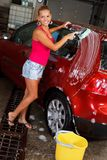 Model washing a car Stock Images
