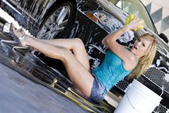Model Washing a Car Royalty Free Stock Images
