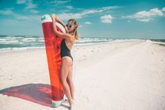 Model with watermelon lilo at the beach royalty free stock photos