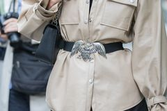 Model Wearing A Beige Jacket And A Belt Decorated With An Armani Eagle Stock Photos