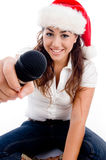 Model wearing christmas hat and showing microphone Royalty Free Stock Photography