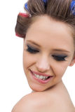 Model wearing hair curlers smiling in close up. On white background Royalty Free Stock Photo