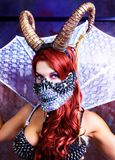 Model wearing Halloween costume of leather and horns stock images