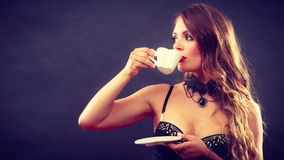 Model wearing lingerie with beverage Royalty Free Stock Image