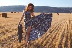 Model wearing maxi dress outdoors Stock Photo