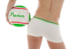 Model wearing Mexico shorts and holding a ball Royalty Free Stock Image