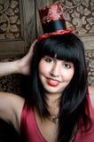 Model Wearing Miniature Hat Stock Photo