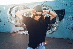 Free Model Wearing Plain Tshirt And Sunglasses Posing Over Street Wall Stock Photo - 100554100