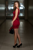 Model Wearing Red Dress And Black High Heel Shoes Stock Photos