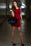 Model Wearing Red Dress And Black High Heel Shoes Royalty Free Stock Photos