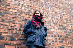 Model wearing scarf and barbour style jacket,. Portrait of a model wearing tartan scarf, barbour style jacket, skynny black jeans and suede brown ankle boots Stock Photos