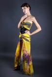 Model Wearing Tie Dye Yellow Dress Stock Photo