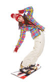Model wearing winter suit holding a snowboard Stock Images