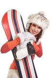 Model wearing winter suit holding a snowboard. Model wearing snowboard suit holding a snowboard in studio royalty free stock photos