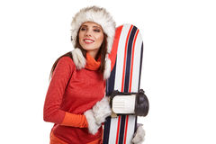 Model wearing winter suit holding a snowboard Royalty Free Stock Photos