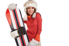 Model wearing winter suit holding a snowboard Royalty Free Stock Image