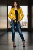 Model Wearing Yellow Leather Jacket Stock Image