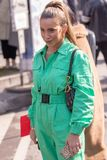 Model wears a green work overalls. Milan, Italy - February 21, 2019: Model wears a green work overalls during the Armani fashion show for the autumn / winter royalty free stock photography