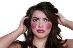 Model wears lipstick on cheeks Stock Images