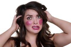 Model wears lipstick on cheeks Stock Photo