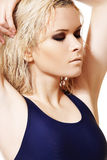 Model with wet blond hair, dark make-up, pale skin Stock Images