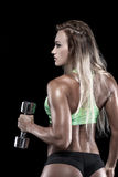 Model with wet body holding dumbbells Royalty Free Stock Photos
