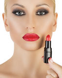 Model on white background applying red lipstick Royalty Free Stock Image