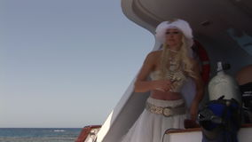 Model in white costume of pirate on ship near water in Red Sea. stock footage