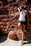 Model in white near ruin. Stock Images