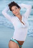 Model with white shirt against blue water Stock Photography