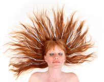 Model With White Twigs in Her Sprawled Out Hair royalty free stock image
