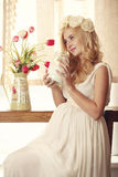 Model, woman, blonde, pregnant in the interior Royalty Free Stock Images