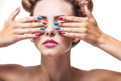 Model, a woman with bright makeup and bright nail Polish on a wh Royalty Free Stock Photo