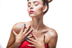 Model, a woman with bright makeup and bright nail Polish on a wh Stock Photos