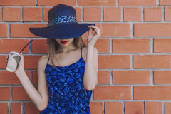 Model woman with Cup of coffee in wicker hat Stock Photo