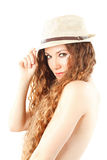 Model woman in fashion hat with curly long hair Stock Photos