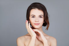 Model Woman with Healthy Skin and Natural Makeup on Gray Bac Stock Photo
