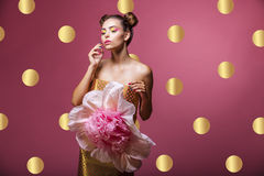 Model woman in paper gift box in pink peas Royalty Free Stock Photo