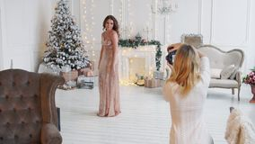Model woman posing for a photograph in Studio Christmas stock footage