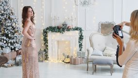 Model woman posing for a photograph in Studio Christmas stock video footage