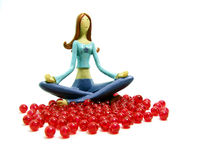 Model woman and red pearls. On the physical level, yoga postures, called asanas, are designed to tone, strengthen, and align the body Stock Photo