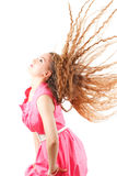 Model woman shaking head with long hair. Beautiful model woman shaking head with long hair on white background. More of this series on my portfolio Stock Photo