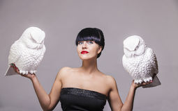 Model woman with two decorative white owl Royalty Free Stock Photography