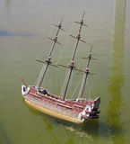 Model of the wooden antique sailing ship on wated Stock Photography