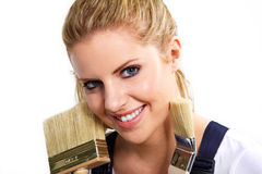 Model works with a paintbrush Royalty Free Stock Image